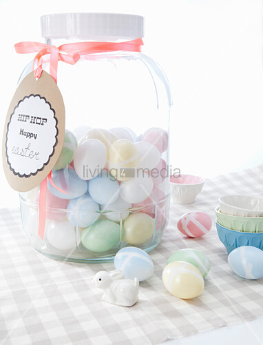 Pastel sugar eggs in sweet jar