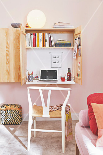 A mini office space contained in a wall cupboard