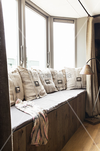 Cushions with buckles on window bench in window bay