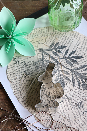 Rabbit biscuit cutter on collage of torn newspaper