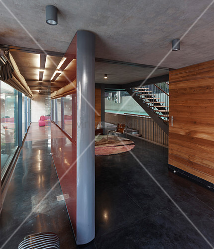 Partition wall in modern architect-designed house made of concrete and steel