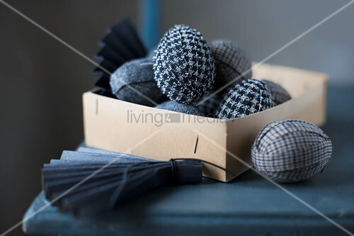 Easter eggs wrapped in fabric in box
