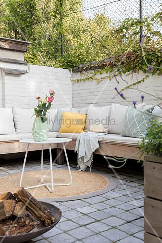 Cushions on corner bench in courtyard garden