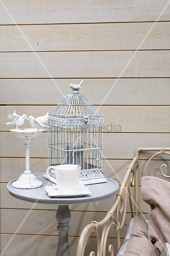 Bird-cage lamp on side wall against board wall