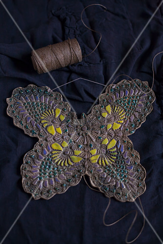Clay butterfly embossed with lace pattern and painted