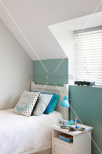 White and pale green walls in child's attic bedroom
