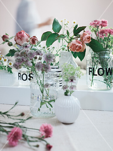 Homemade Vases Made From Screw Top Jars With Stick On Flowers Bild