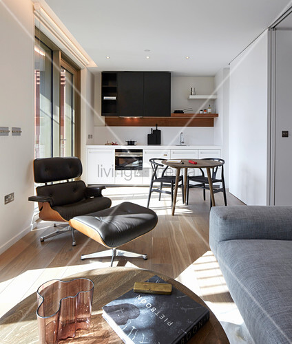 View from living room into open-plan kitchen with large TV