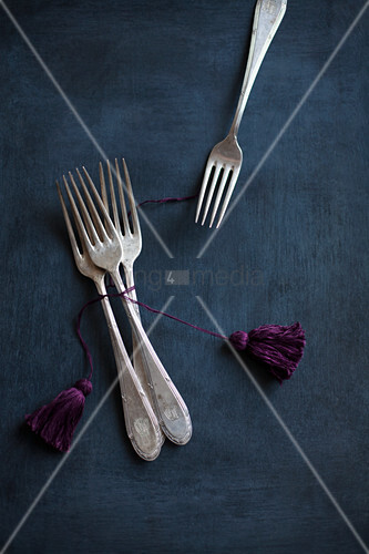 Vintage cutlery with hand-made tassels