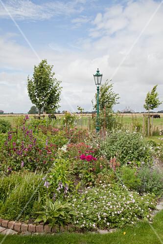 Flowerbed with stone edging in garden