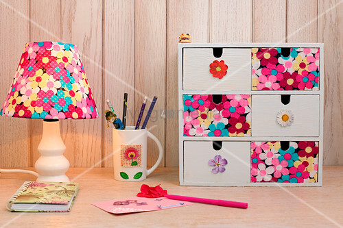 Table lamp and small set of drawers decorated with floral fabric