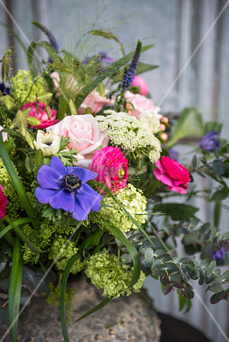 Colourful spring bouquet with blue, pink and green flowers