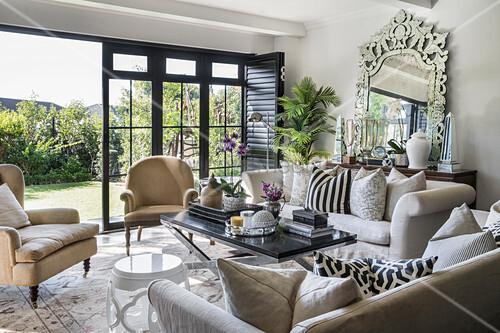 Glamorous bedroom with open terrace doors leading to garden