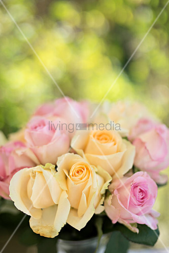 Bouquet of summery roses on table