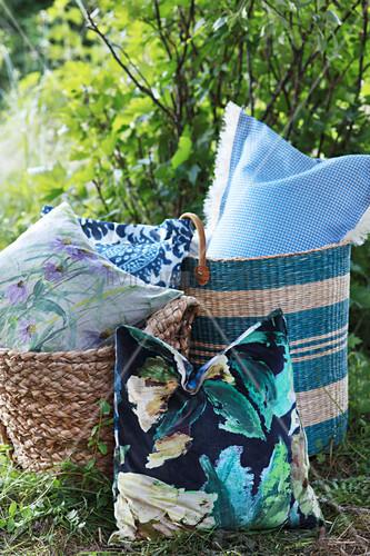 Cushions in woven bags in garden
