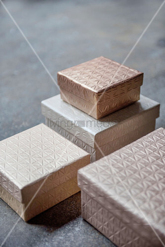 Four boxes in shades of champagne with structured surfaces