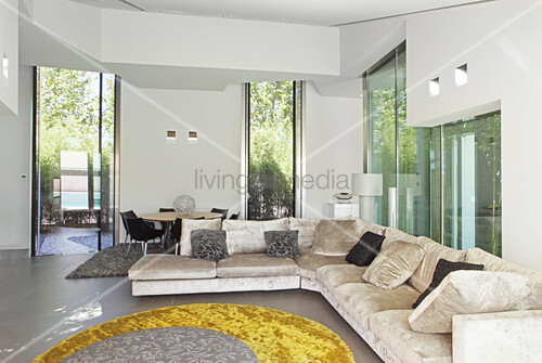 Glass walls with view of bamboo garden in modern living room