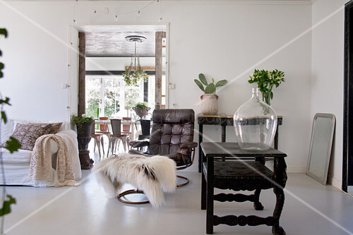 Eclectic living room with white floor