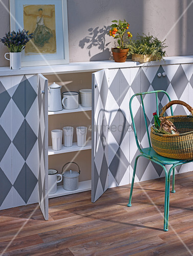 Slim, fitted sideboard with diamond-patterned front and open doors showing interior