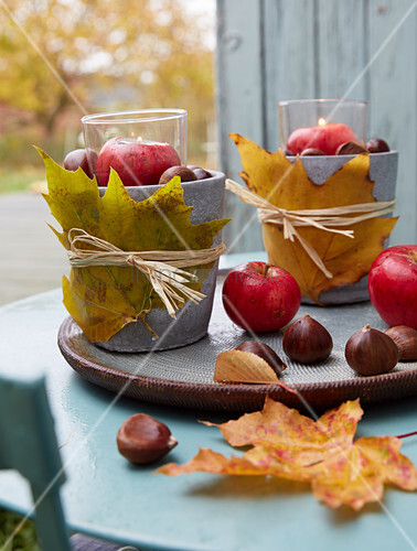 DIY lanterns with autumnal leaves, chestnuts and apples