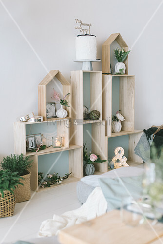 Festive ornaments on modular shelves made from various wooden boxes