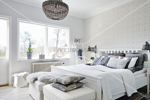 Bright bedroom in white and grey