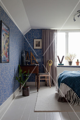 Blue and white bedroom with floral wallpaper