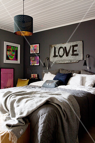 Sign reading 'LOVE' above bed in grey bedroom