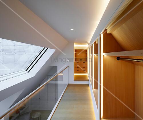 Walk-in wardrobe on gallery above bedroom
