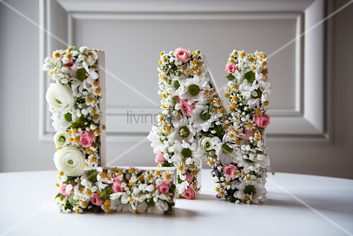 Ornamental letters romantically decorated with flowers