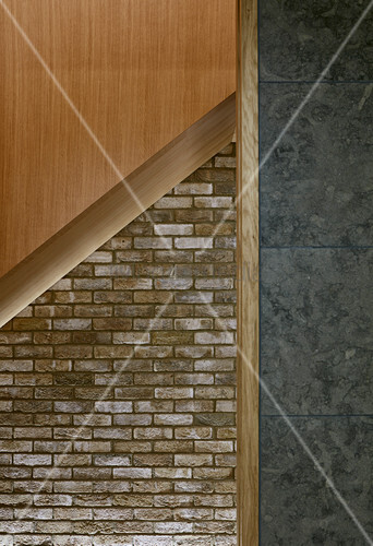Pattern of straight lines in modern architect-designed house in mixture of materials