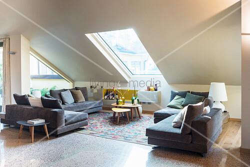 Sofa in set in elegant attic living room