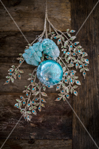 Ornamental leafy branch and turquoise Christmas decorations