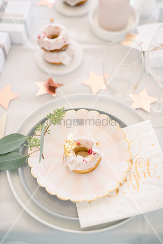 Donut on plate on modern Christmas table