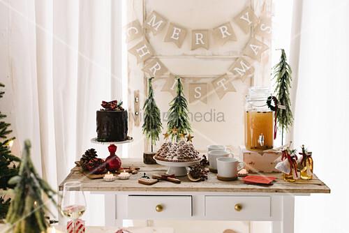 Hot apple punch, bundt cake and drip cake on dessert buffet