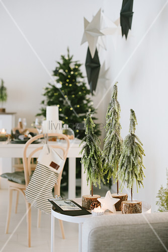 Hand-crafted Christmas-tree ornaments in festively decorated interior