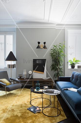 Elegant designer furniture in living room of period apartment
