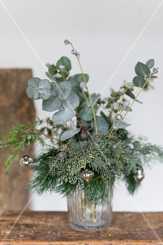 Wintry bouquet of various green twigs