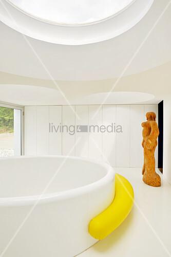 Large round bathtub in minimalist bathroom