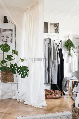 Curtain screening walk-in wardrobe in bedroom