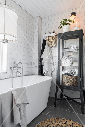 Display case next to free-standing bathroom
