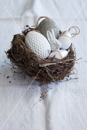 Decorative eggs and Easter bunny in Easter nest