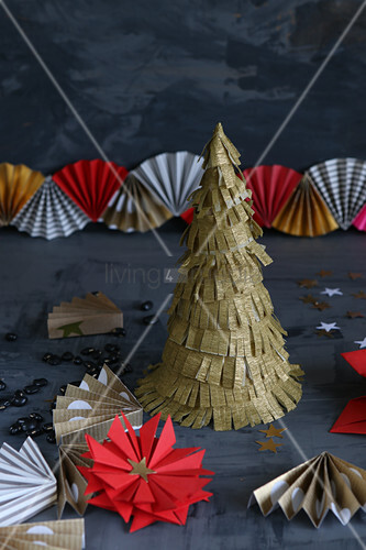Christmas decorations hand-made from red and gold paper