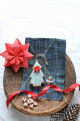 Paper star and Christmas tree on embroidered denim