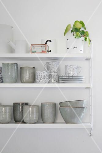 Simple crockery on kitchen shelves