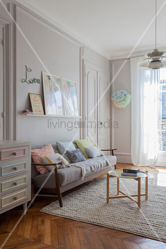 Pastel accessories in nursery with pale grey walls