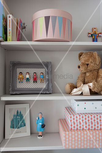 Toys on pale grey shelves