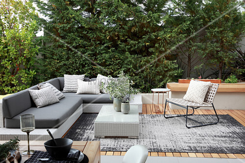 Grey outdoor furniture on elegant wooden terrace
