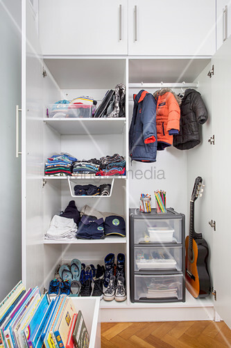 Boy's clothing in wardrobe with open doors