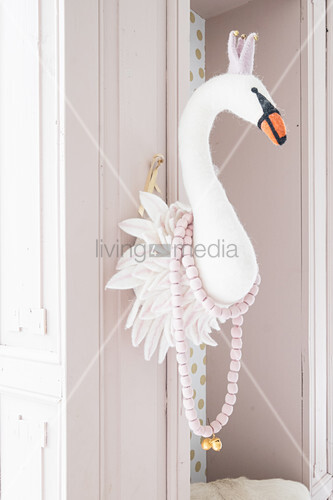 Faux swan head on door frame